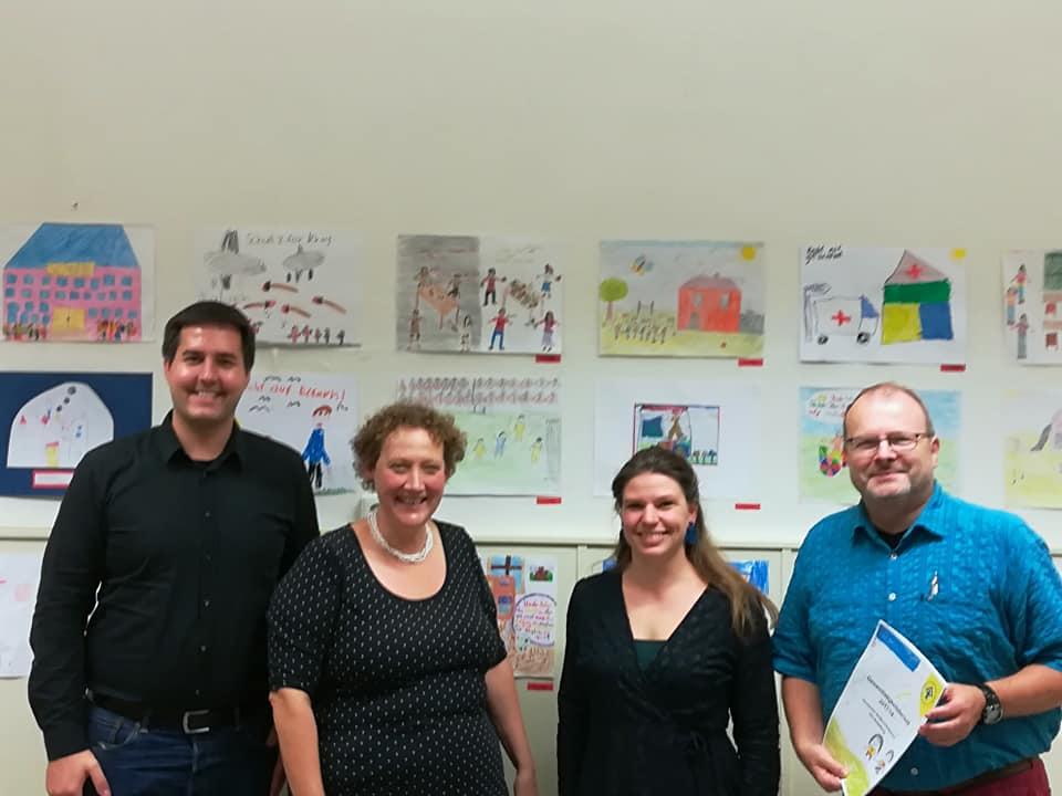 Gruppenfoto v.l.: Stadtrat Andreas Grasser, Claudia Kaufmann und Eva Hasel (beide Kinderschutzbund Heidelberg) und Stadtrat Karl Emer
